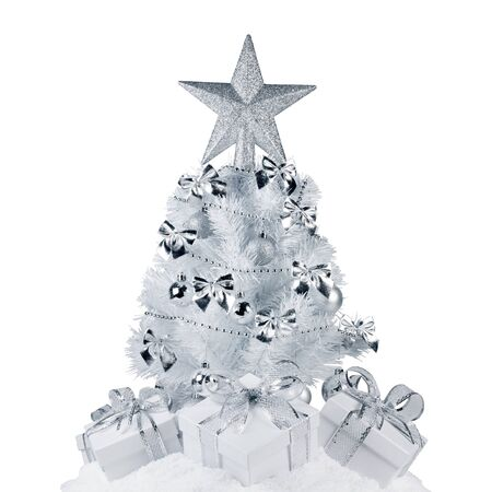 White christmas tree with silver decorations and gifts on snow isolated on white background Stockfoto