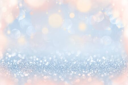 Colorful festive lights over silver glitters abstract background, Christmas New Year party celebration concept Stockfoto