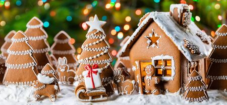Gingerbread house christmas fir trees gift and animals cookies winter holiday celebration concept