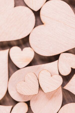 Many wooden colorless hearts background, two special ones true love concept Stock Photo