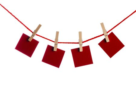 Set of four red blank paper notes held on a string with clothespins isolated on white background 版權商用圖片
