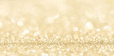 Shiny golden bokeh glitter lights abstract background, Christmas New Year party celebration concept Reklamní fotografie