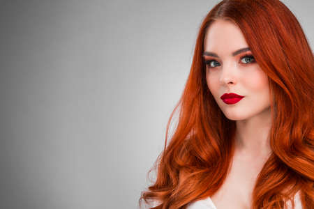 Beautiful Woman with Red Hair and bright makeup