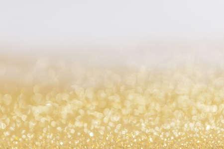 Abstract golden glitter background of shiny lights bokeh Christmas New year celebration luxury party Standard-Bild