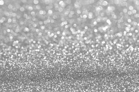 Shiny silver bokeh glitter lights abstract background, Christmas New Year party celebration concept