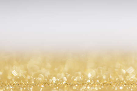 Abstract golden glitter background of shiny lights bokeh Christmas New year celebration luxury party