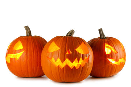 Three Halloween Pumpkins isolated on white background Imagens