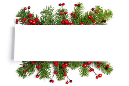 Christmas Border frame of tree branches and red berries on white background with copy space isolated