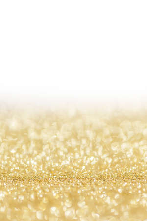 Shiny golden bokeh glitter lights abstract background, Christmas New Year party celebration concept Stock fotó