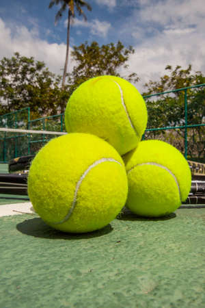 Tennis balls on the court close-up Stock Photo