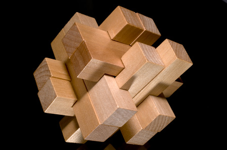 abstract 3d blocks: Building blocks forming a challenging puzzle isolated on a black background