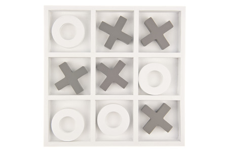 Wooden noughts and crosses game board in gray and white colours isolated in gray background photo