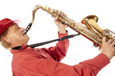 Male performer playing a brass tenor saxophone with silver valves and pearl buttons with expression photo