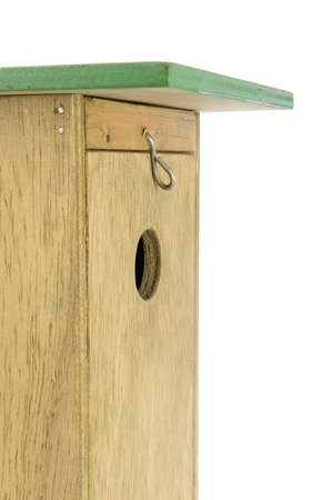Side view of handmade wooden bird house in close up photo