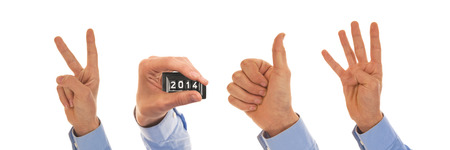 figuring: Male hands with analog pedometer display figuring the year 2014 Stock Photo