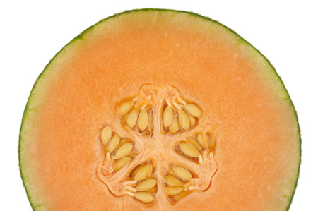 One half of an orange honeydew melon isolated in white  photo