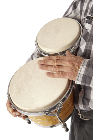 drumming: Male figure playing and drumming on bongo set under the arm