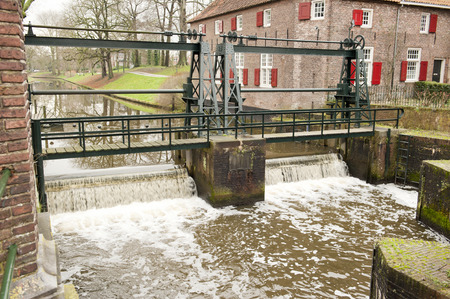 watermanagement: Sluice with running water spill at Grote Koppel, Amerfoort, the Netherlands on januari 24, 2014 Stock Photo