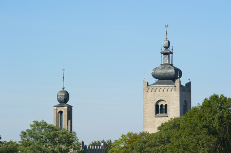 Historic towers of the monastery of the Order of the Holy Cross at Amersfoort, the Netherlands above surrounding tree tops on september 6, 2010 photo