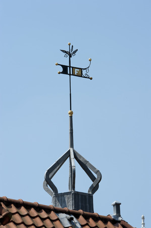 Rooftop with ornamental decorated crown shaped windvane at Amsterdam, the Netherlands on june 23, 2010 photo