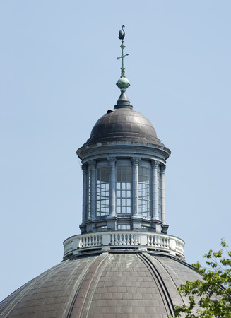 Historic tower dome and chapel with weathervane swan of the Lutheran Church at Amsterdam, the Netherlands on october 4, 2010 Stock Photo