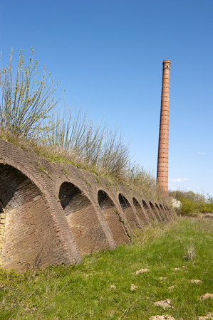 Ancient Dutch brick factory with brick kiln oven holes and chimney