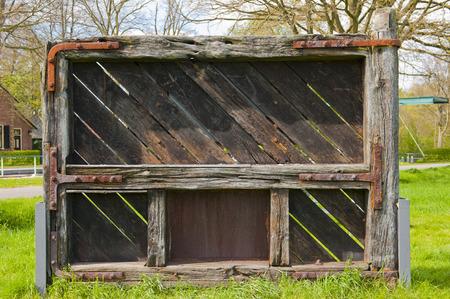 weatherworn: Historic worn and torn lock gate of the Henzenbergersluis in the Apeldoorns channel at Hattem, the Netherlands