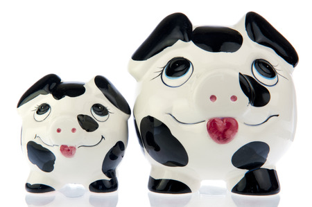 Two money saving pigs, mother and baby in black and white, next to each other photo