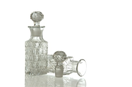 facet: Two sparky glass olive oil flagons with decorative facet structure and plug Stock Photo