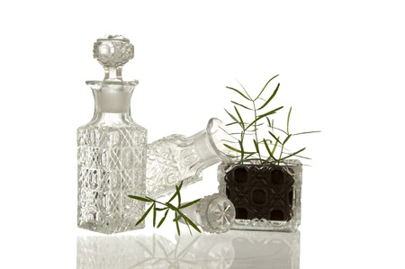 facet: Sparky crystal glass bottles and flask with decorative facet structure and plant Stock Photo