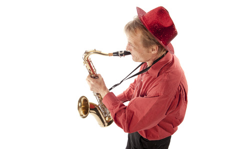 the tenor: Male performer playing a brass tenor saxophone with silver valves and pearl buttons from above