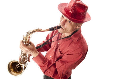 Male musician with hat playing a brass tenor saxophone from above photo