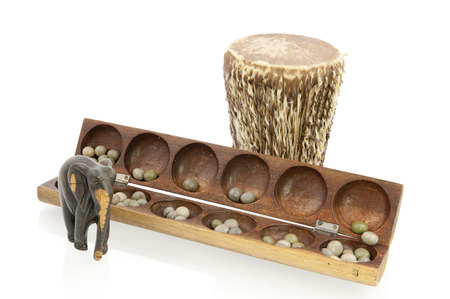 African drum carved from tree with elefant and awale game photo
