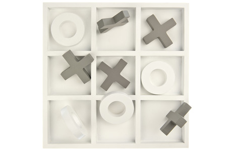Wooden noughts and crosses game board in gray and white colours and mixed stones isolated in white background photo