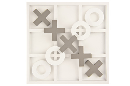 Wooden noughts and crosses game board in gray and white colours and ornate stones isolated in white background photo