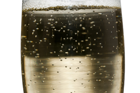 carbonic: Bubbles sparkling in a glass of champagne, in closeup and isolated in white Stock Photo