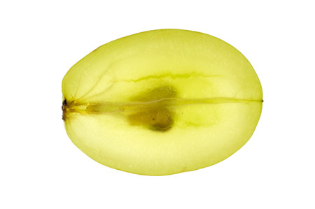 A green grape with grape-stones cut across and isolated in white photo
