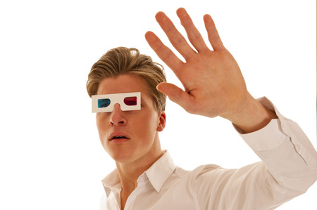 Boy with white shirt and red blue 3d movie glasses looking scared photo
