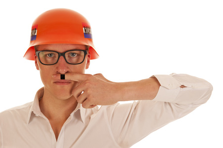 Boy with white shirt and orange German party war helmet and Hitler moustache on finger photo