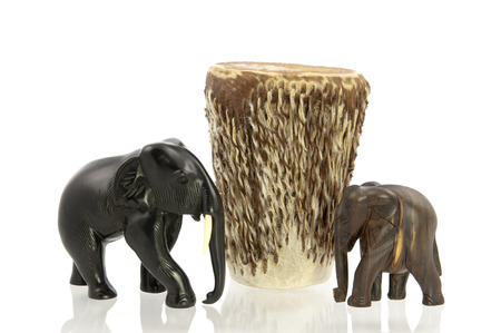 adjacent: Two elefants standing adjacent to an African drum Stock Photo