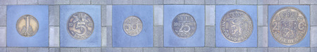 florin: Collection of former Dutch coins cemented in sidewalk, presented in a row                Stock Photo