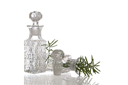 Two sparky glass olive oil flagons with decorative facet structure and plugs photo