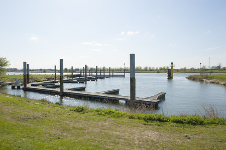 landing stage: Wooden footpath of landing stage at waterside in a river landscape
