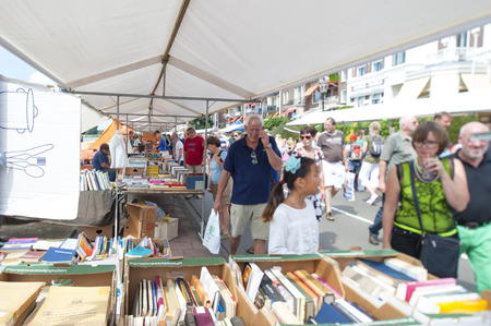 DEVENTER, THE NETHERLANDS - AUGUST 3, 2014  The Deventer book market in the Netherlands on august 3, 2014  The boulevard crowded with people scouring the book stalls