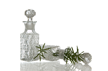 spunky: Two sparky glass vinegar bottles with decorative facet structure plugs and plant