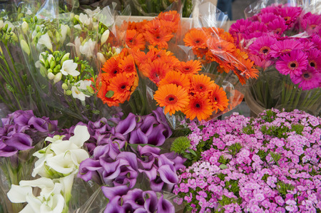 Arrangement of assorted cut flowers in a market stall photo