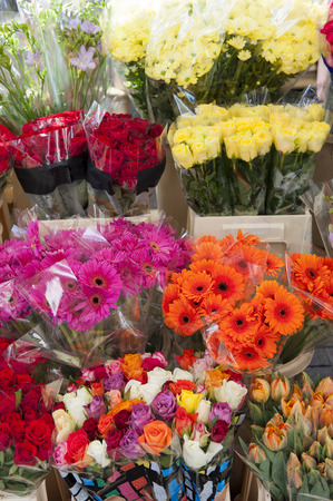 Colorful arrangement of assorted cut flowers in a market stall photo