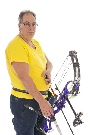 bowman: Guy with yellow shirt and jeans standing with a longbow