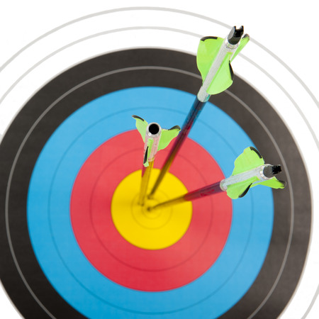 The bull's eye of an archery target hit by three arrows is a square frame
