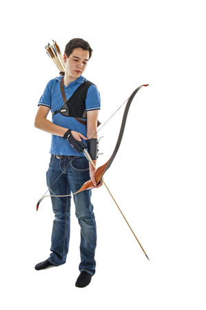 weaponry: Boy with blue shirt and jeans holding a longbow